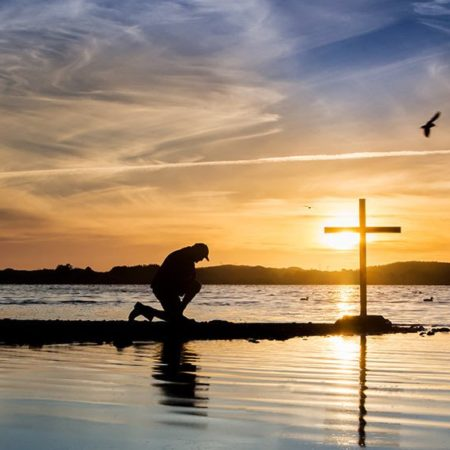 man-kneeling-prayer-cross-water